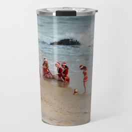 Christmas background. Happy girls in Santa Clause suit having fun on the beach. Travel Mug