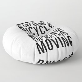 Life is like riding a bicycle. White Background. Floor Pillow
