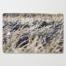 green grass in the frost Cutting Board