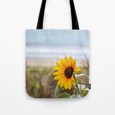 Sunflower near ocean Tote Bag