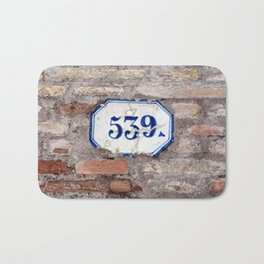 Number 539 on brick wall Bath Mat