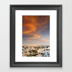 Orange sunset at the rocks Framed Art Print