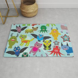 Cute cartoon Monsters seamless pattern on blue background Rug