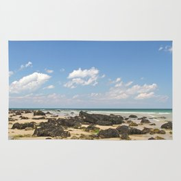 Sunny day by the Ocean Rug