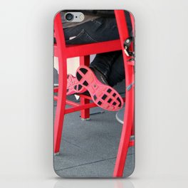 Sitting Cross Legged On The Red Chair iPhone Skin