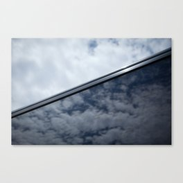 Sky reflection in car window Canvas Print