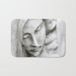 Angel face on stone memorial eyes closed Bath Mat