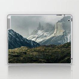 Menacing Mountain peaks with fog coming in Laptop & iPad Skin