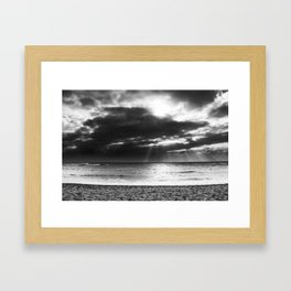 ray of sun over the beach at Kauai, Hawaii with cloudy sky in black and white Framed Art Print