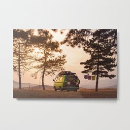 Old timer camper van parked on the top of the hill between pine trees in the beautiful sunset sky Metal Print