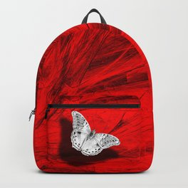 Silver butterfly emerging from the red depths Backpack