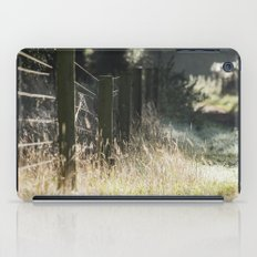 Fence and wild grass growing beside a track. Norfolk, UK. iPad Case