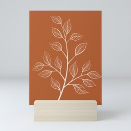 Delicate White Leaves and Branch on a Rust Orange Background Mini Art Print