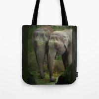 elephants Tote Bags featuring Elephants  by Guna Andersone & Mario Raats - G&M Studi