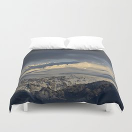 Snowy mountains through the clouds. Duvet Cover