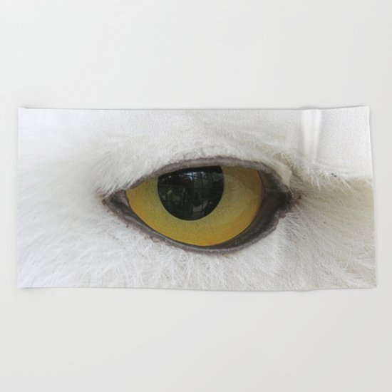 In the eye of a snow owl Beach Towel