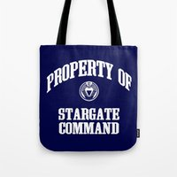stargate Tote Bags featuring Property of Stargate Command Athletic Wear White ink by RockatemanDesigns