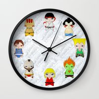 street fighter Wall Clocks featuring A Boy - Street fighter by Christophe Chiozzi