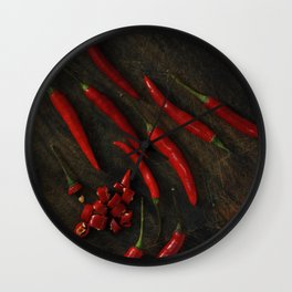 Red chili peppers on rusty wooden board Wall Clock