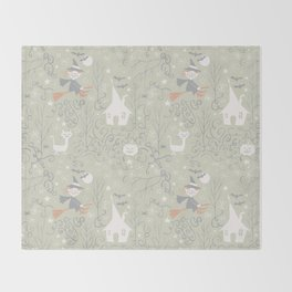 Little witch flying back home in Halloween Throw Blanket