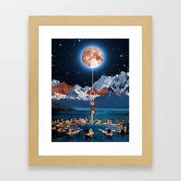 Hanging from the moon Framed Art Print
