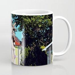 A saint on the local square Coffee Mug