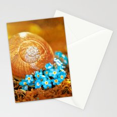 Golden snail house in a bed of forget-me-not Stationery Cards