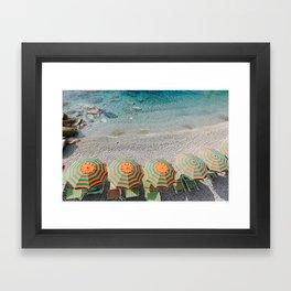 Umbrellas on the beach Framed Art Print