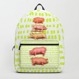 Stack of pigs on the green green grass of home Backpack