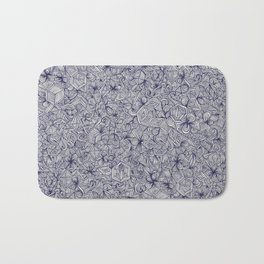 Held Together - a pattern of navy blue doodles Bath Mat