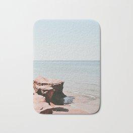 Pink rock ocean Bath Mat