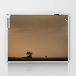 Lone wildebeest grazing in South Africa at sunset Laptop & iPad Skin