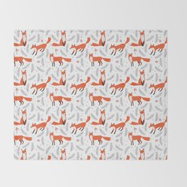 Red foxes and berries in the winter forest Throw Blanket