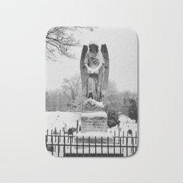 Snow covered angel Bath Mat