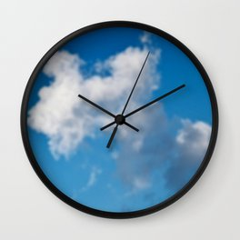Dreaming floating candy on blue Wall Clock