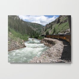 Steam engine train traveling along the Animas river in Colorado Metal Print