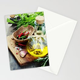 fresh  herbs  with  mezzaluna, olive oil and vegetables on cutting board Stationery Cards