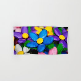 Colored sugared almonds as petals Hand & Bath Towel