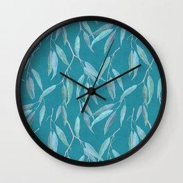 Eucalyptus leaves on bright blue Wall Clock