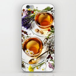 Herbal tea with honey, wild berry and flowers on wooden background iPhone Skin