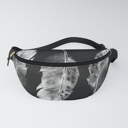 Three feathers on black background Fanny Pack