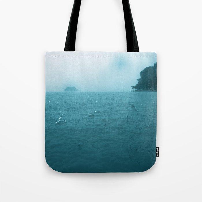 Raining on the ocean Tote Bag