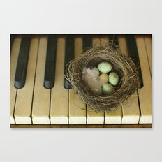 Chocolate Eggs in a Birds Nest on a Vintage Piano. Canvas Print