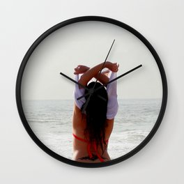 Girl at the beach getting ready for a bath Wall Clock