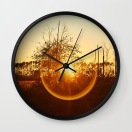 Low Sunset Behind The Trees. Wall Clock
