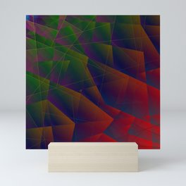 Abstract dark pattern of green and overlapping red triangles and irregularly shaped lines. Mini Art Print