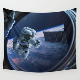 Astronaut in outer space through the porthole Wall Tapestry