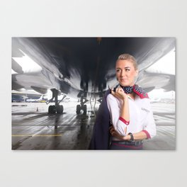Attractive flight attendant near airplane in airport. Canvas Print