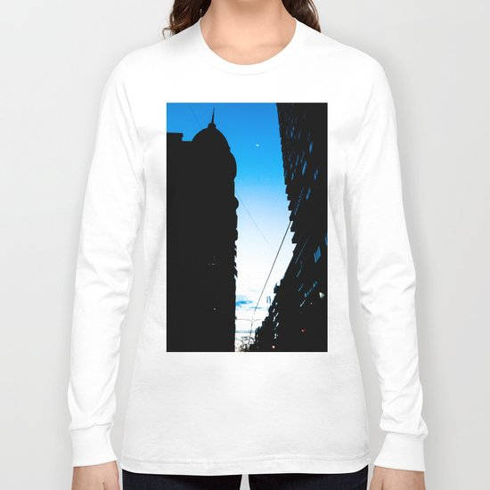 The moon between the buildings Long Sleeve T-shirt