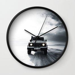 landrover defender in iceland Wall Clock
